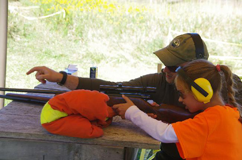 Teaching youth to shoot.